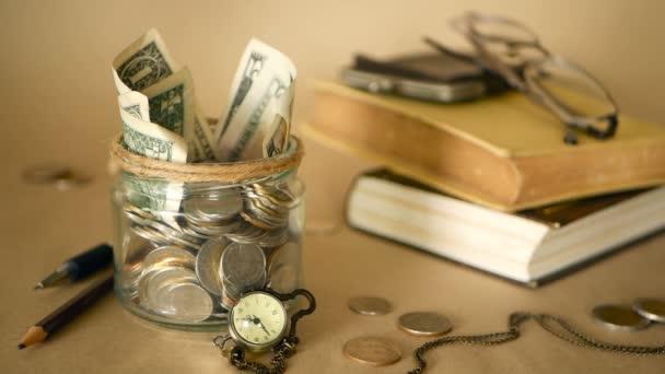 depositphotos_206399688-stock-video-books-with-glass-penny-jar